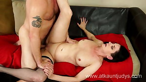 Milf Holiday Hughes fucks her younger lover on a sofa