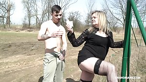 A rich full-grown lady makes a sex toy out of a young man
