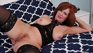 Hot MILF Andi James wears lingerie and masturbates like a god