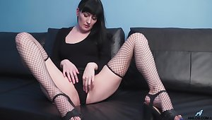 Provocative mature Nimfa in fishnet stockings playing with say no to cunt